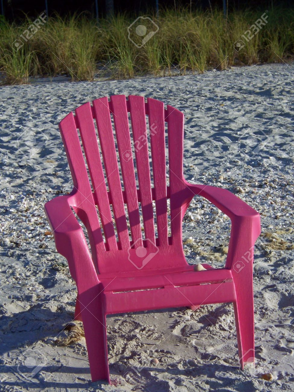 Lovely Bright Pink Colorful Adirondack Chair On Beach Stock Photo   2751521