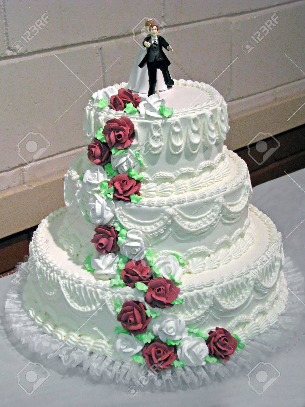 Creamy White Wedding Cake With Burgundy Roses Stock Photo Picture