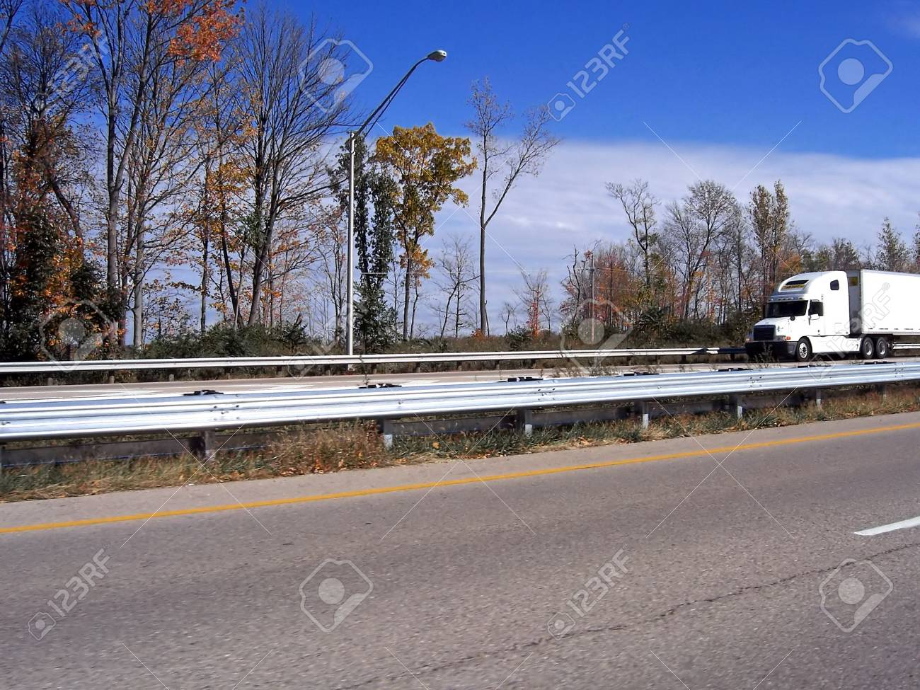 semi trailer truck driving on divided highway Stock Photo - 3351277