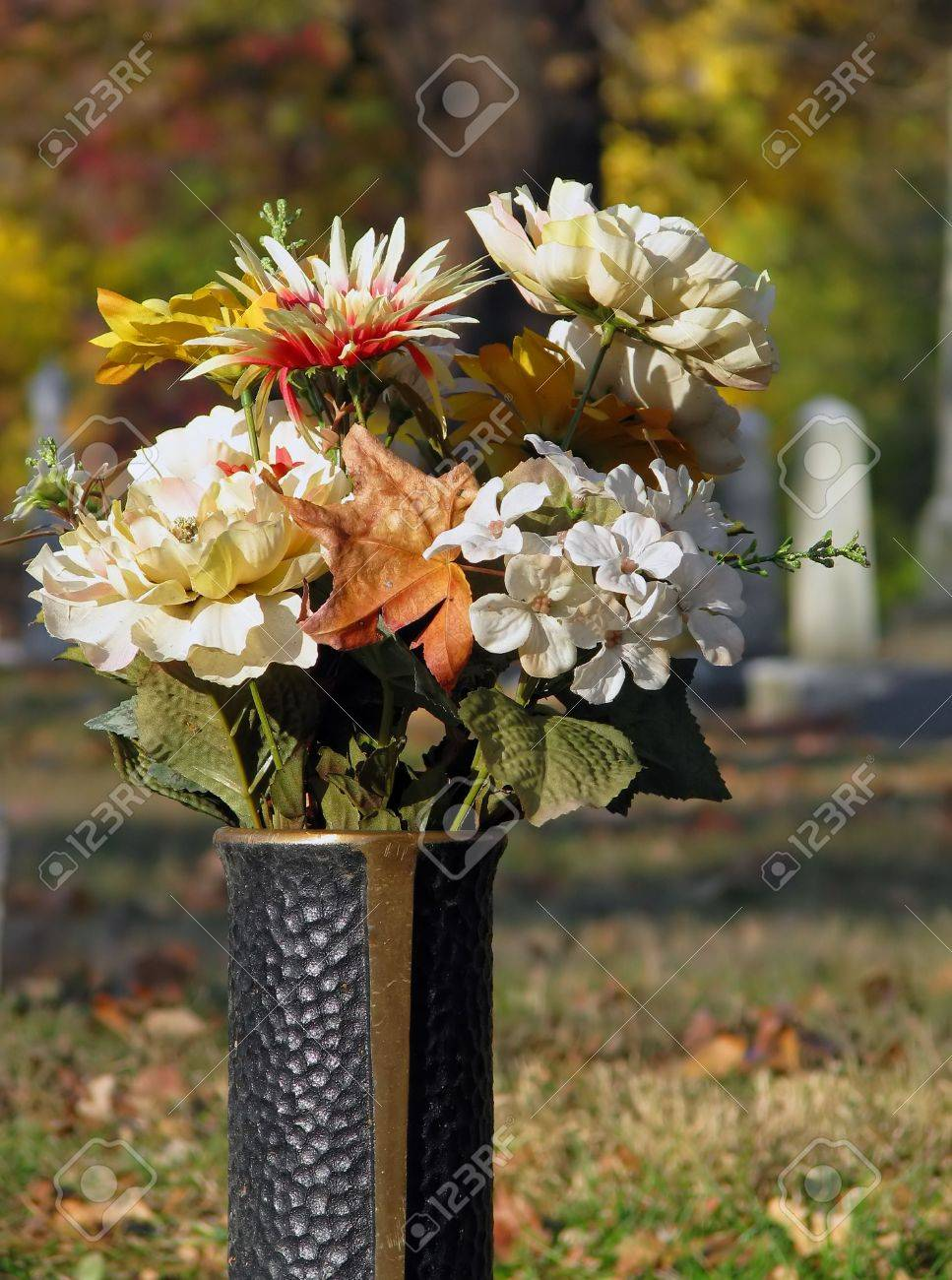 Silk Flowers In Cemetery Grave Vase Autumn Stock Photo Picture And