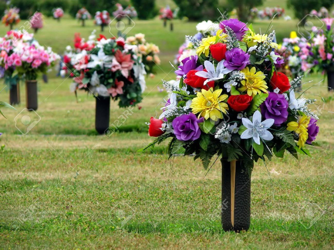 123RF.com & colorful silk flower vases in summer cemetery