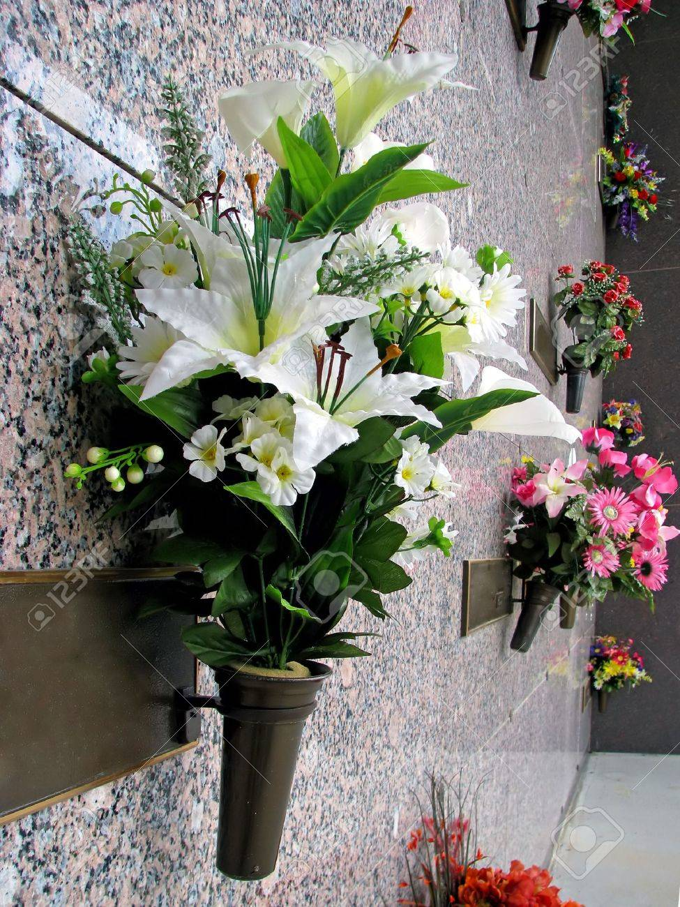 123RF.com & colorful silk flower vases in summer cemetery