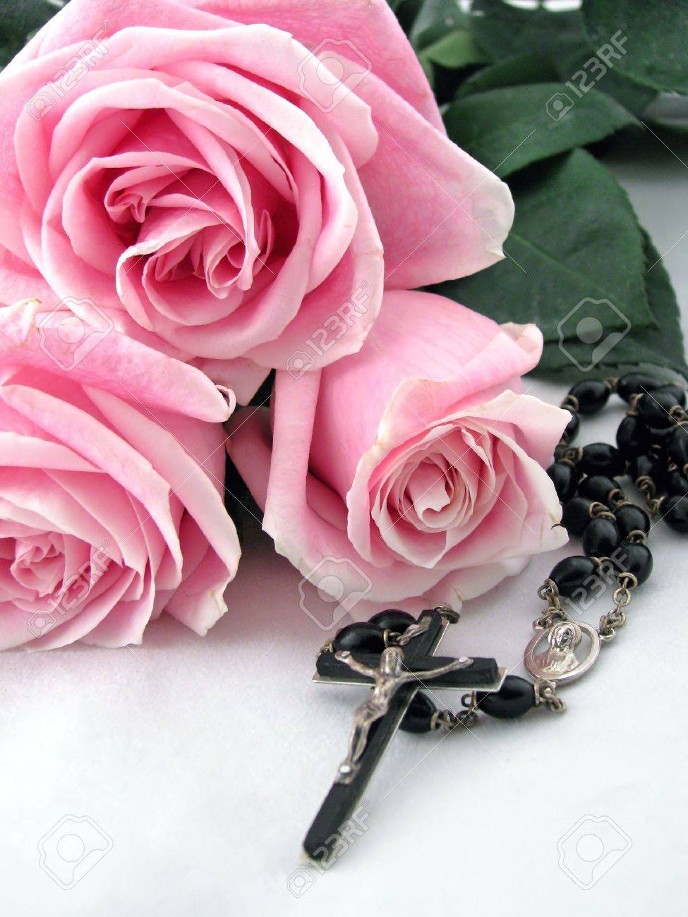A rosary cross surrounded by pink roses stock photo picture and a rosary cross surrounded by pink roses stock photo 5046408 izmirmasajfo