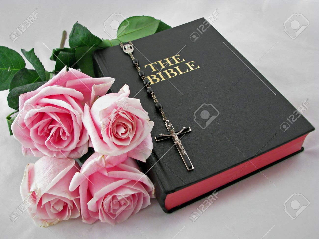 a rosary cross pink roses and bible Stock Photo - 5065877