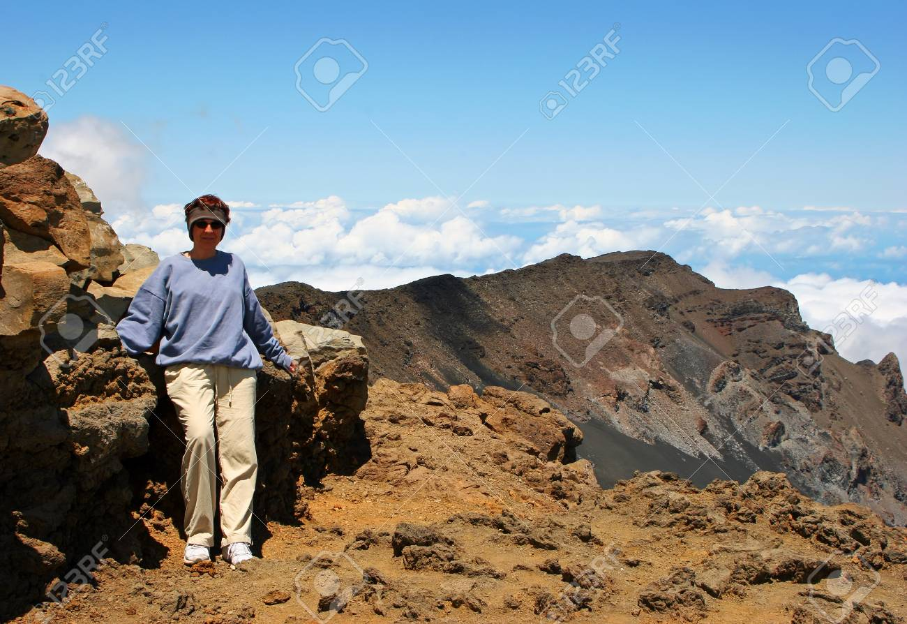 Middle-age Woman Standing on top of Mountain Stock Photo - 13792104