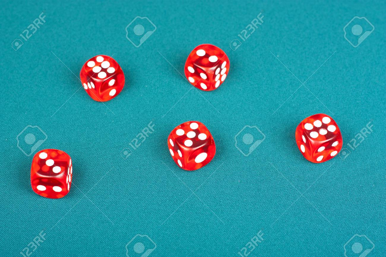 Poker table background - Five Dice On The Green Poker Table Background Stock Photo 9220743