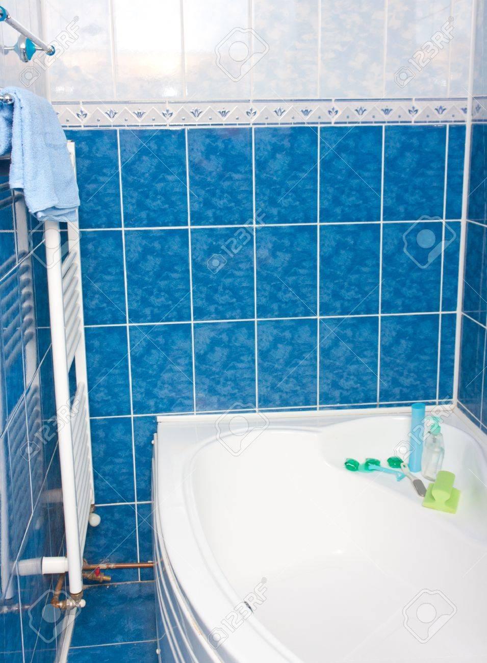 Modern bathroom with blue tiles,  bathtub and radiator Stock Photo - 9551376