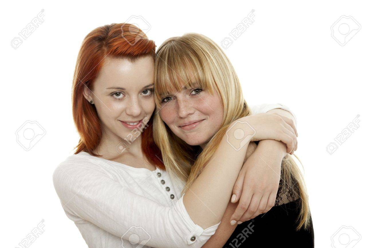 young beautiful red and blond haired girls are best frinde in front of white background Stock Photo - 15353159