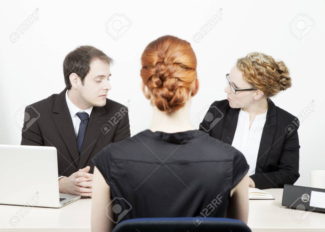 a male and female business executive conducting a job interview a male and female business executive conducting a job interview a redhead w applicant who