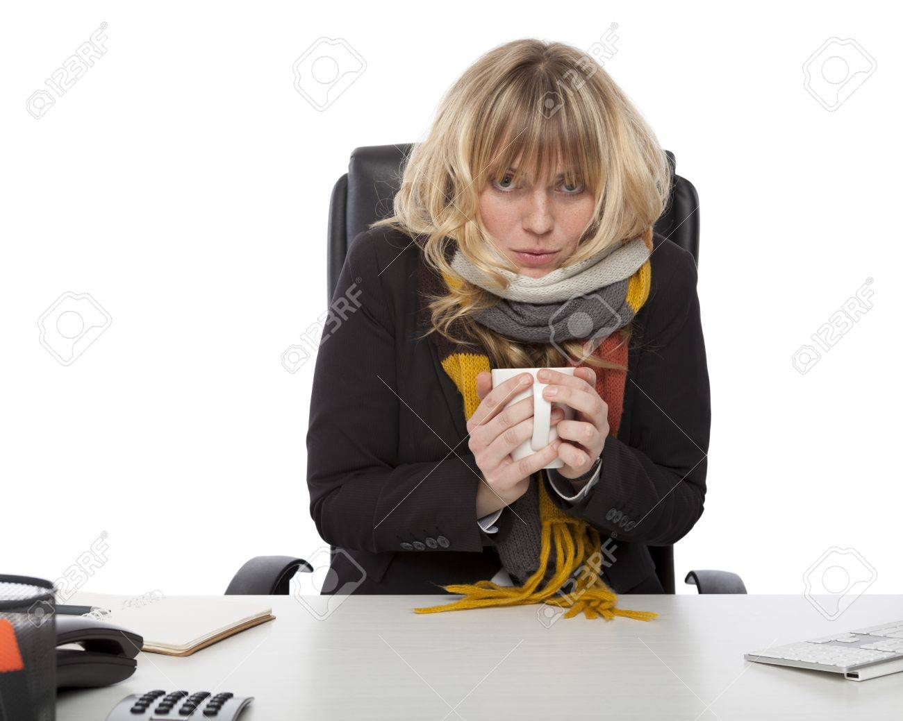 Freezing Cold Businesswoman Wearing A Knitted Winter Scarf Sitting