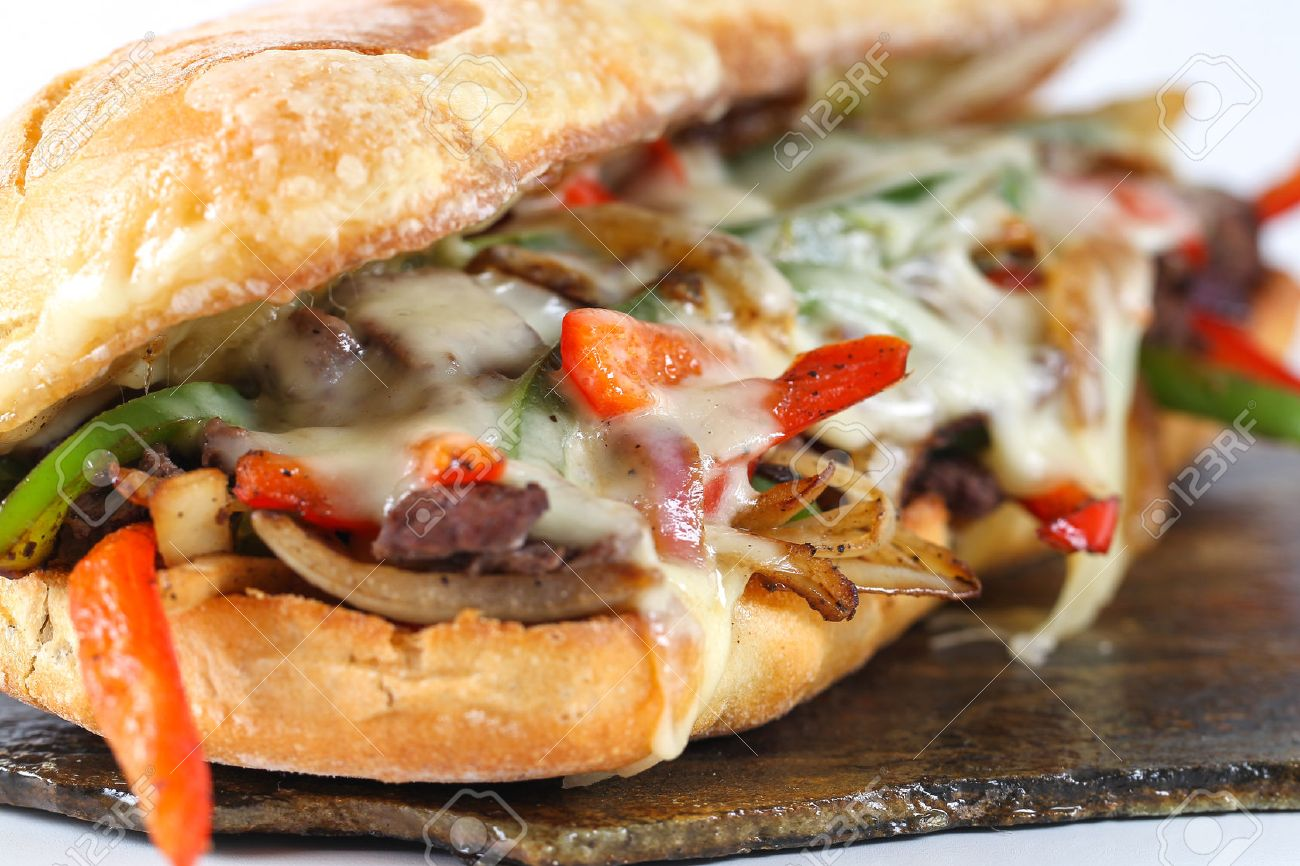 Tasty beef steak sandwich with onions, mushroom and melted provolone cheese in a ciabatta - 52275398