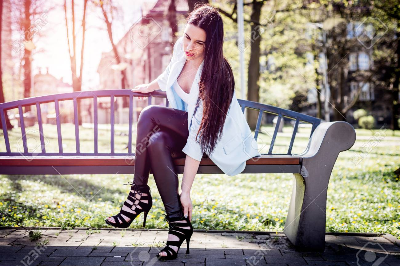 b2c8b0b29ca9 101496457-feeling-pain-in-the-foot-while-wearing-high-heels-the-woman -sat-on-the-bench-holding-her-hand-for-th.jpg