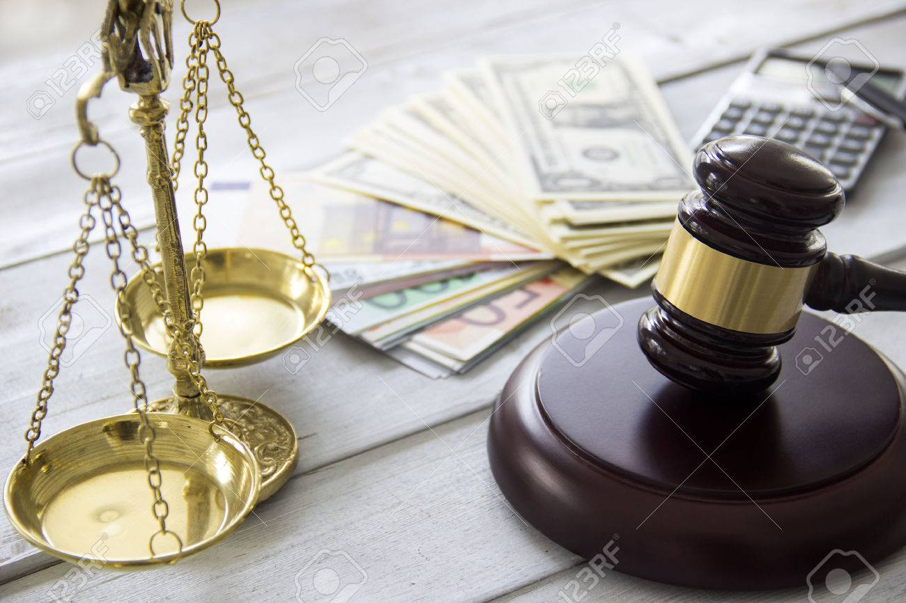 Labor law concept, scale, gavel, money and calculator - 50956990