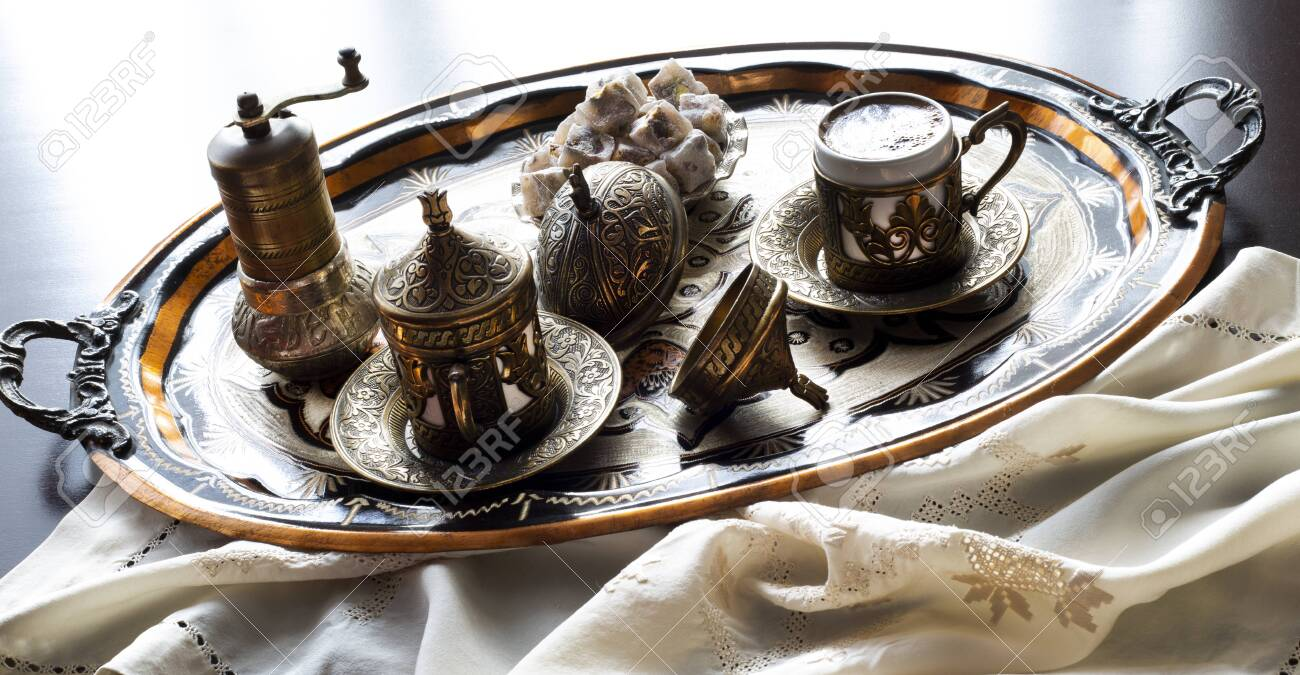 Turkish coffee with delight and traditional copper serving set. Feast of Ramadan. - 148645463
