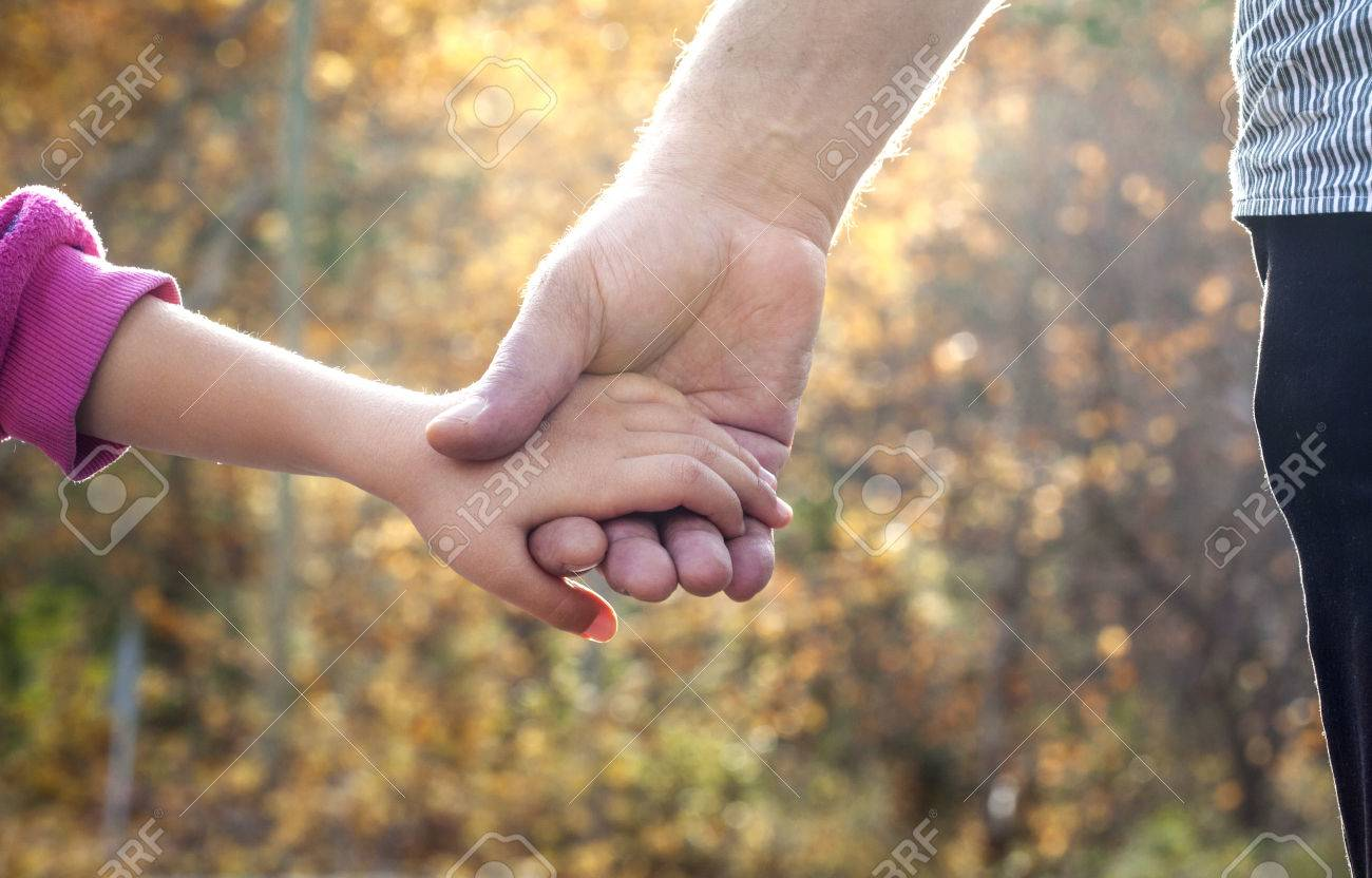 Father And Daughter Holding Hand By Hand Stock Photo Picture And