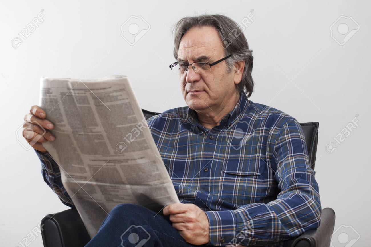 senior man reading newspaper stock photo, picture and royalty free