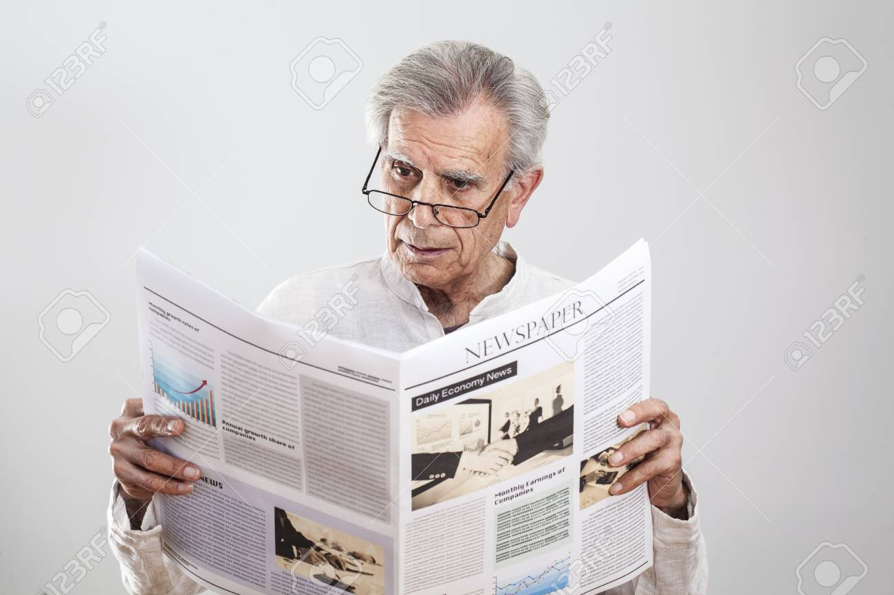 portrait elderly man reading newspaper stock photo, picture and