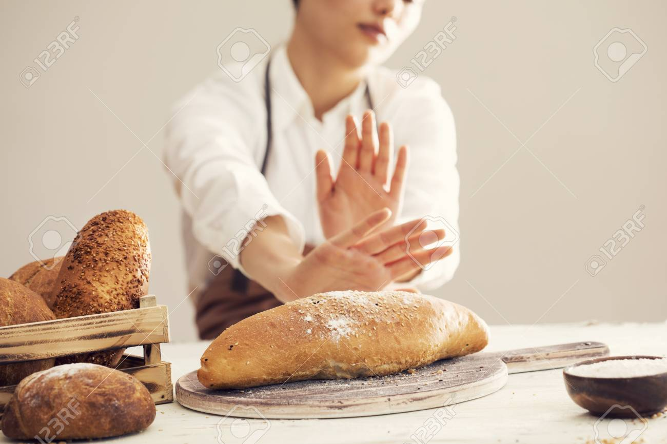 Woman Refusing To Eat White Bread Stock Photo, Picture And Royalty Free Image. Image 79245247.