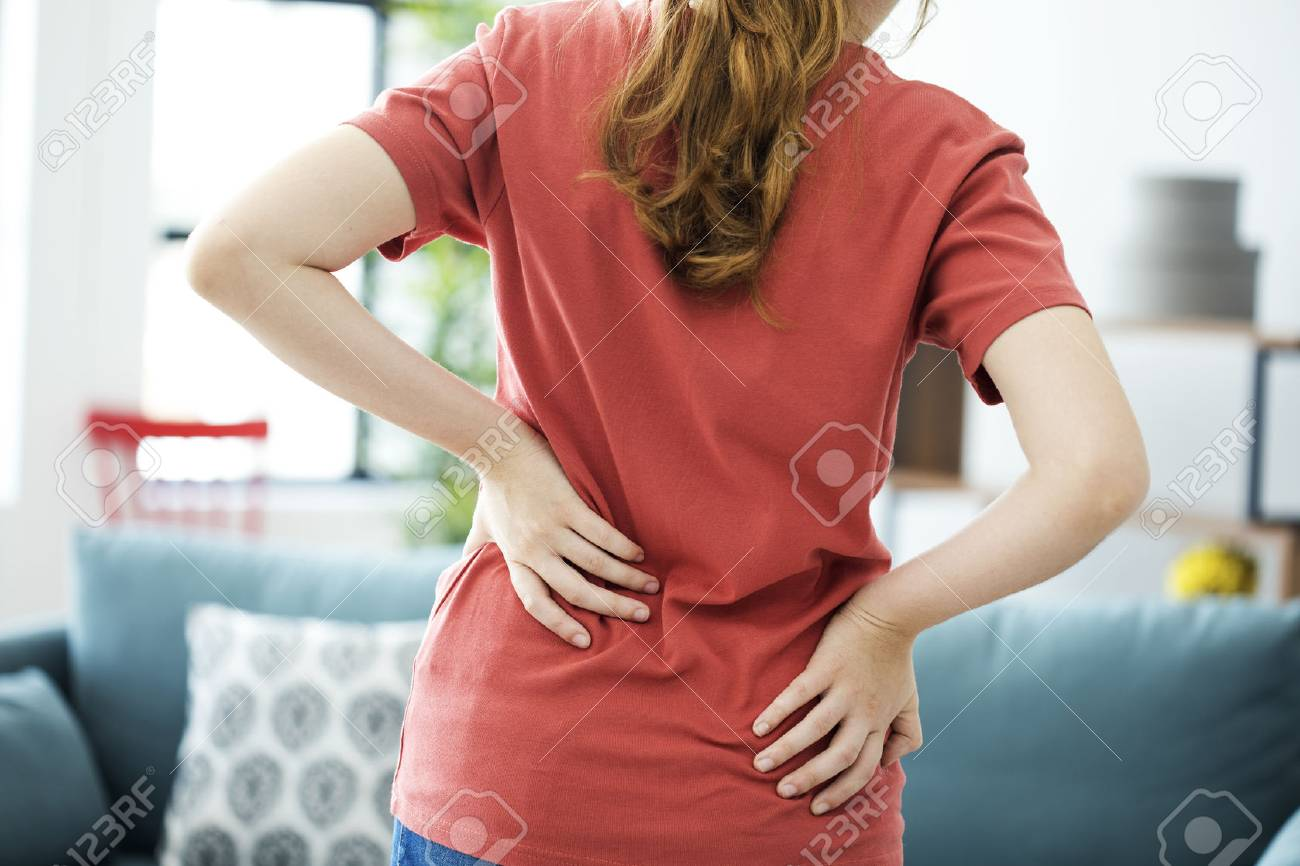 Young woman with back pain - 88262051