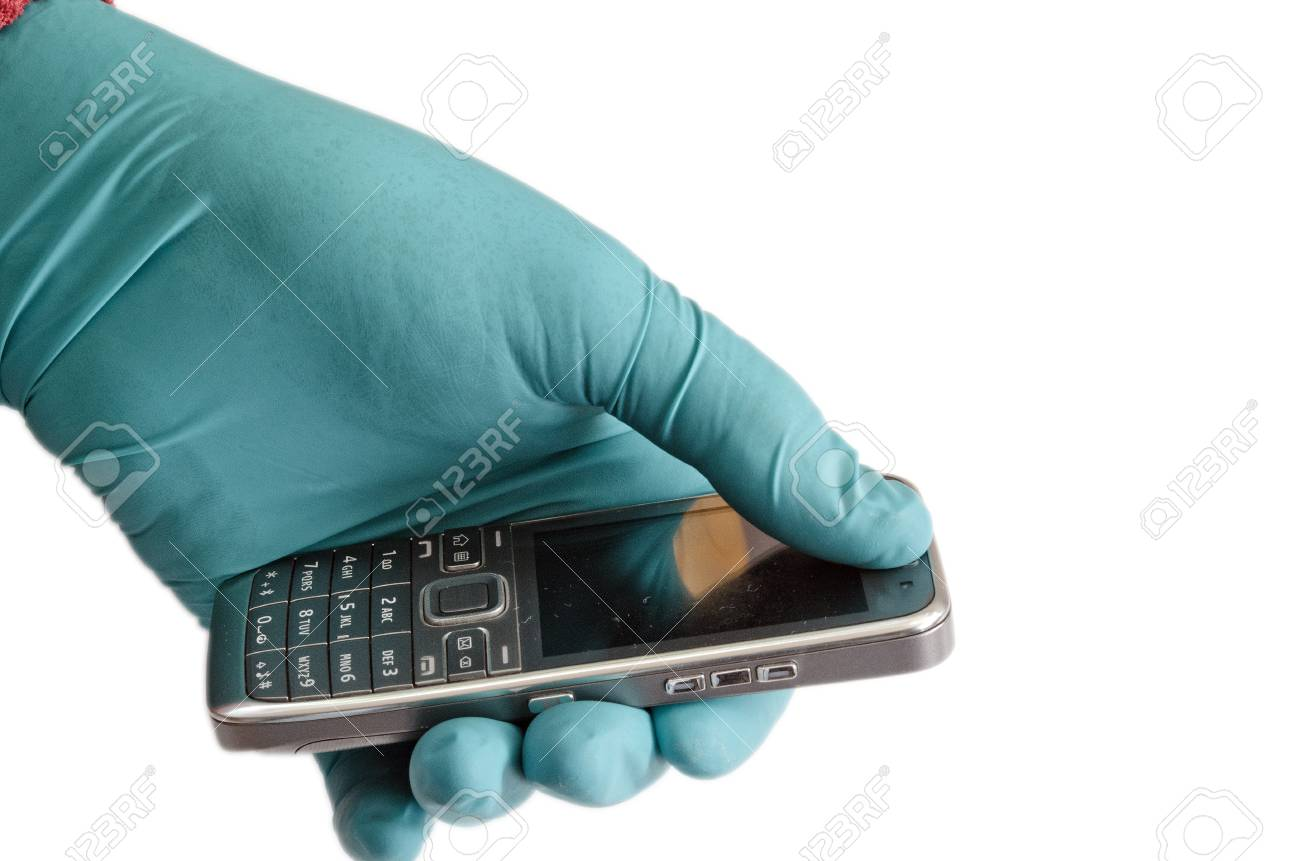 Gloved hand with mobile phone Stock Photo - 12458326
