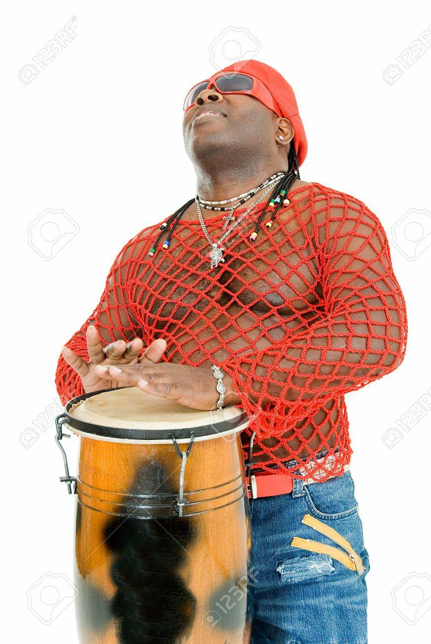 young handsome cuban man plays on percussion Stock Photo - 4415443