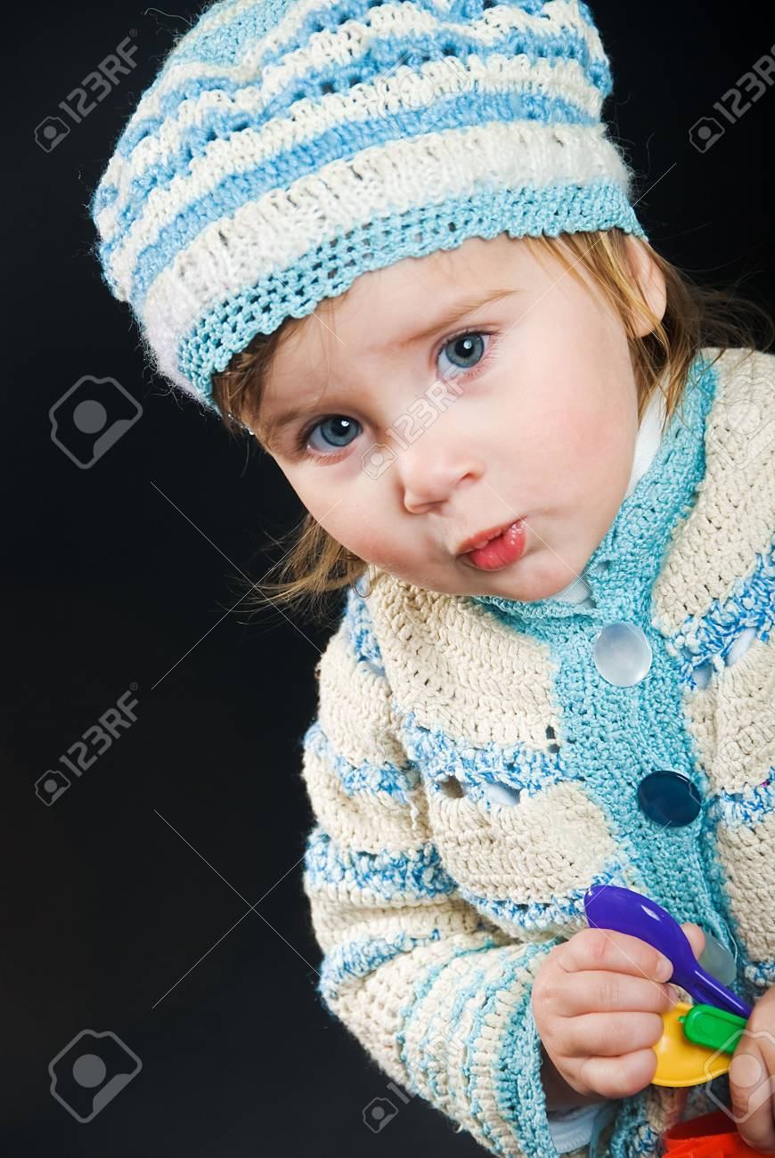 little baby in a bound suit on black background, she learns to speak Stock Photo - 5902891