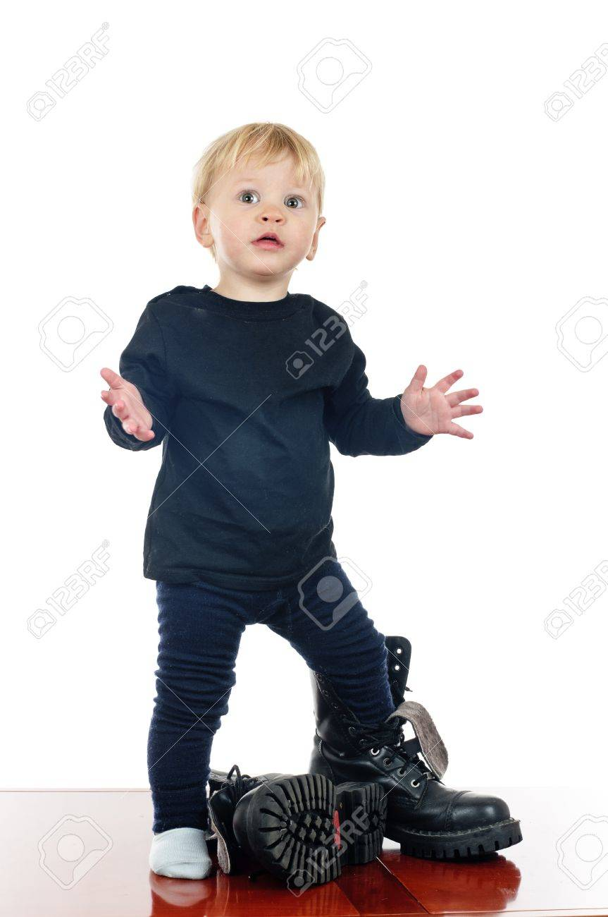 two years old boy in big shoes on white Stock Photo - 10086808