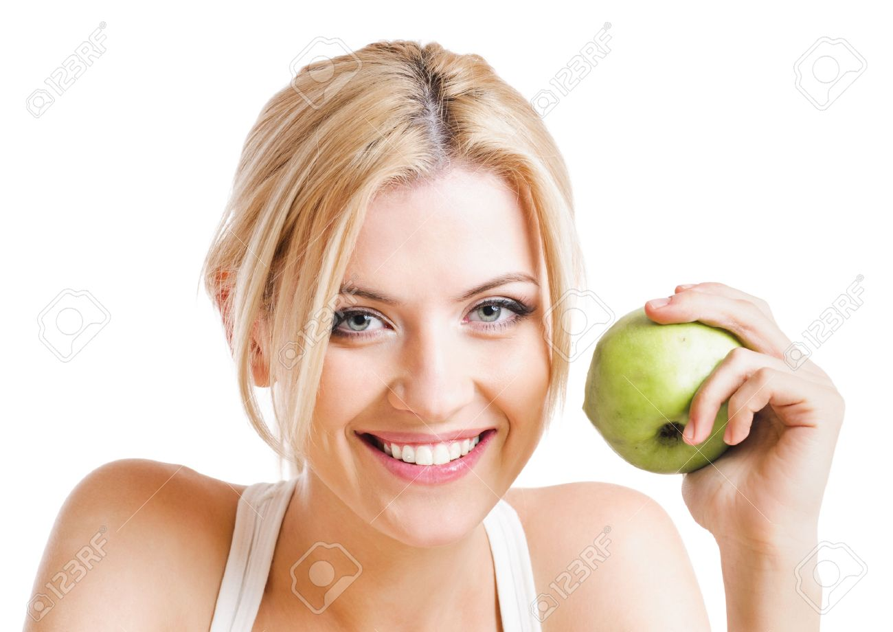 blond woman with green apple. - 33062352