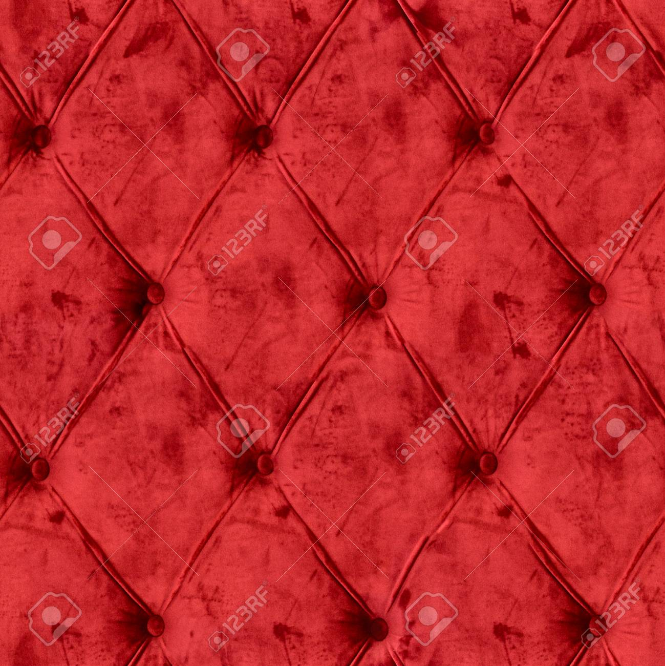 Closeup of elegent luxury red velvet sofa pattern with buttons,..