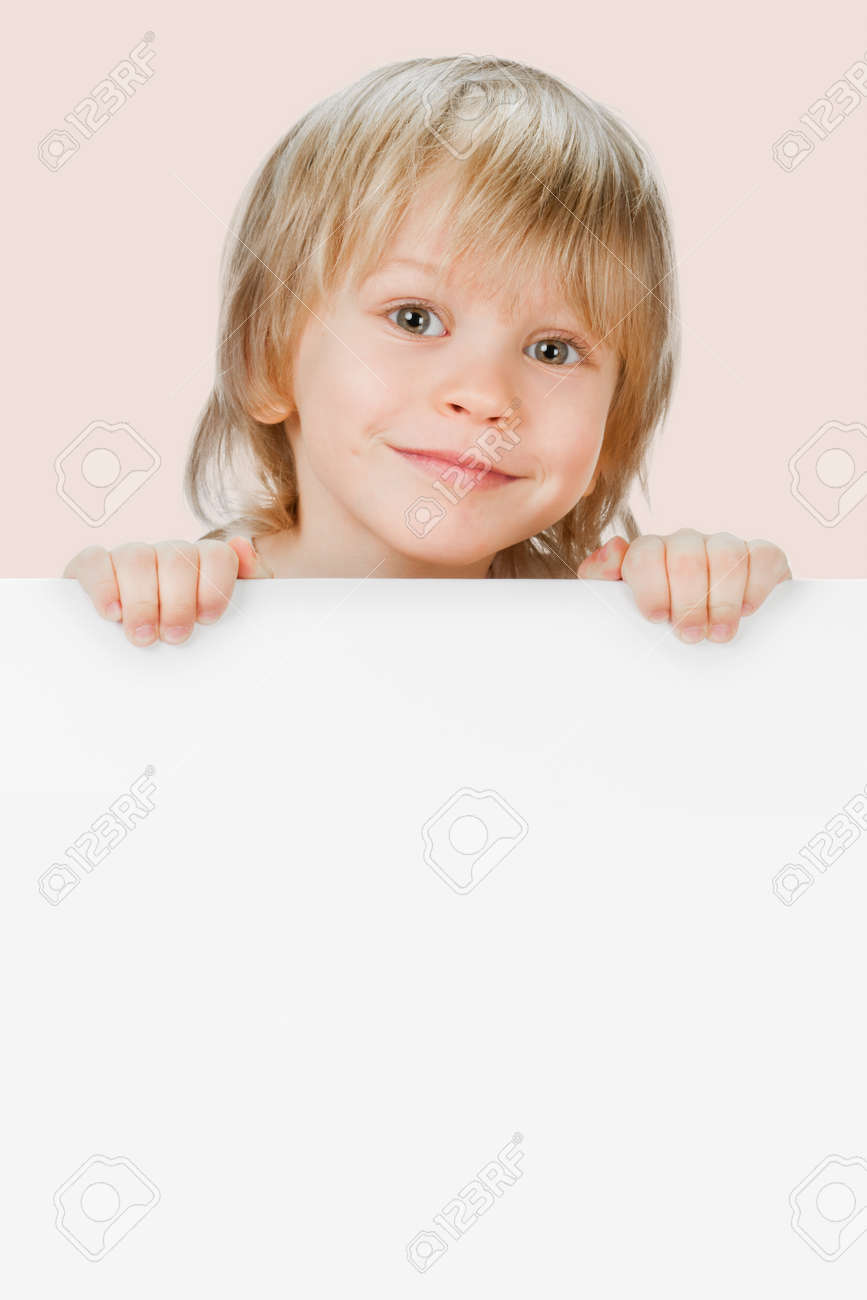 Little smiling child holding empty white poster - 165655369