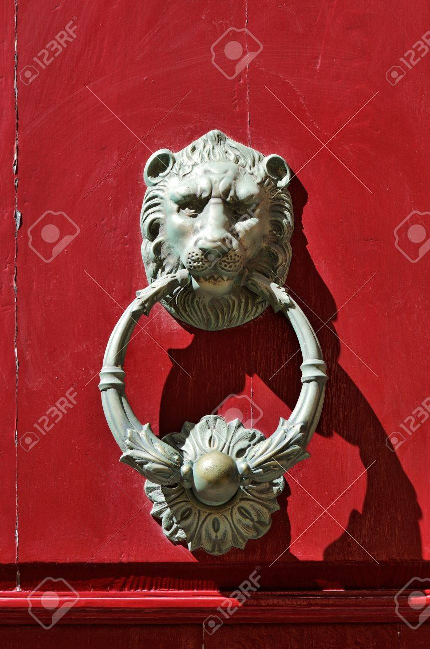 Bronze lion door knocker on red door in Mdina, Malta. Stock Photo - 11695787
