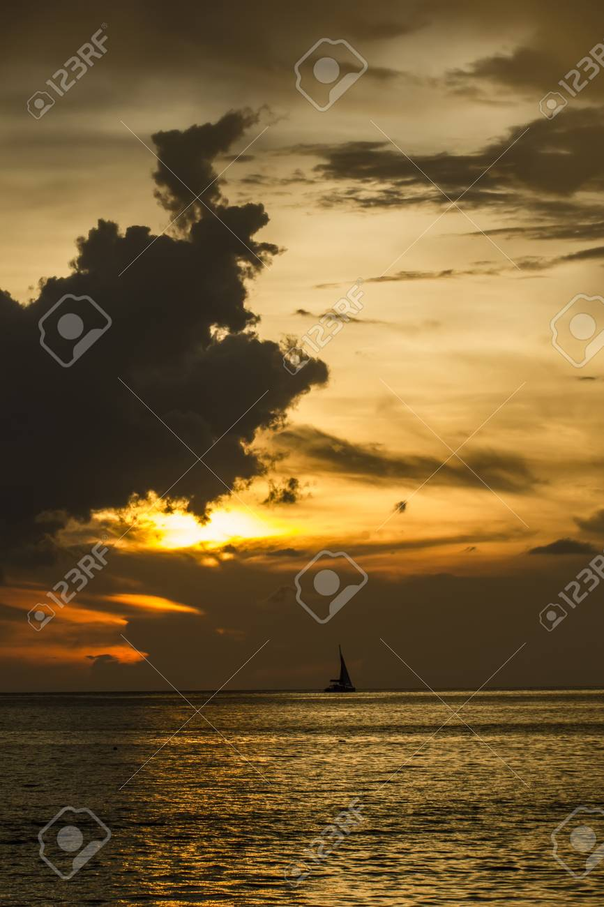 A sailing boat in the sea during the sunset Stock Photo - 17414975