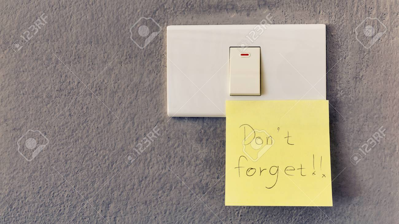 Light Switch On The Wall With A Reminder To Turn Off Stock Photo ...