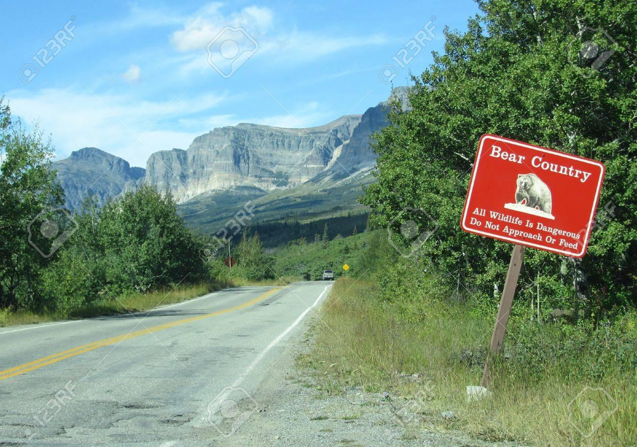 A Bear Country warning sign near a road inside Glacier National Park, Montana, U.S.A. Stock Photo - 14717153