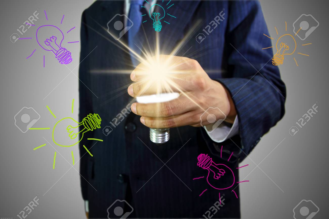 Picture of hand holding a light bulb. Stock Photo - 12391227