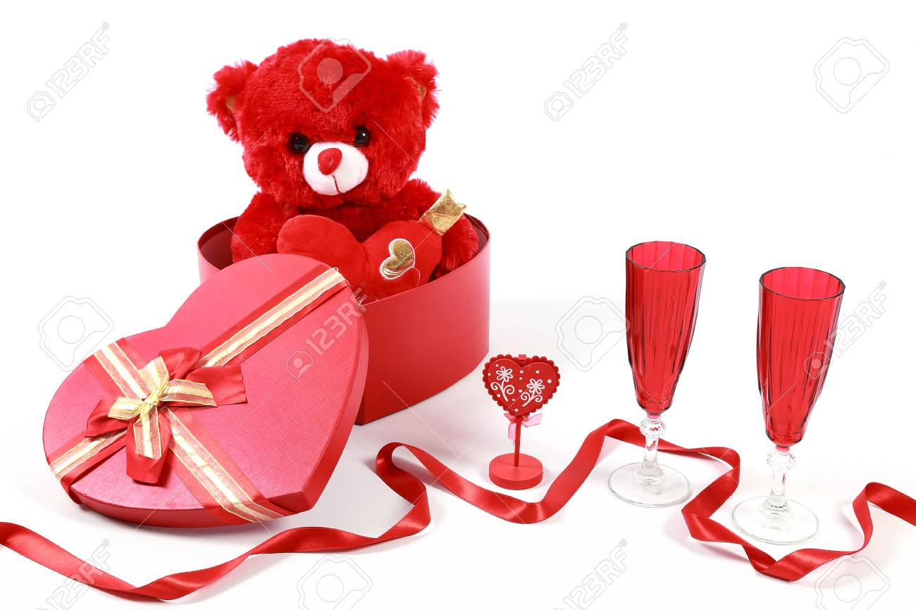 7cb579ee Valentine's Day concept. Red teddy bear in heart shaped gift..