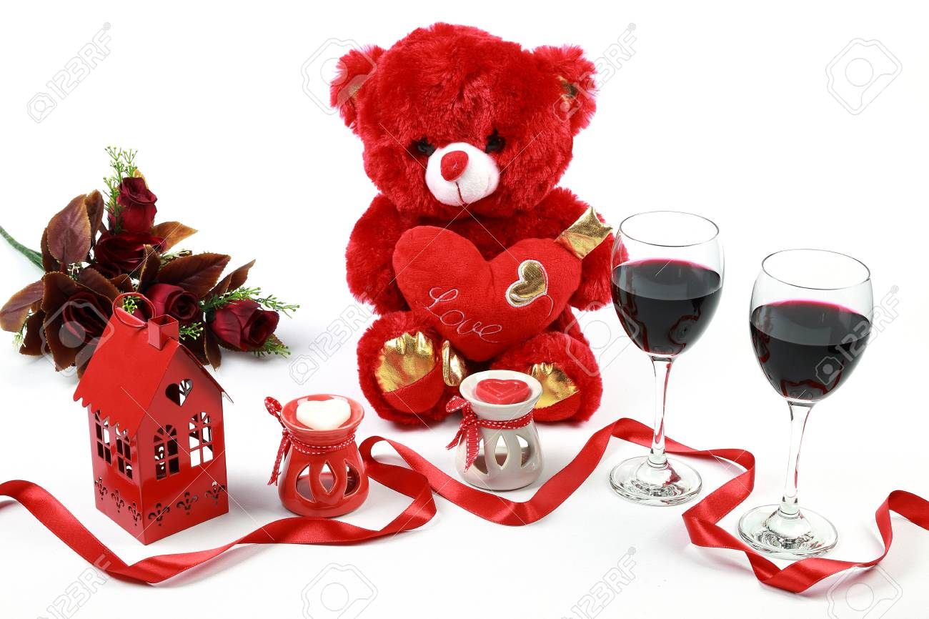 c5123633 Valentine's Day concept. Red teddy bear with red wine and heart..