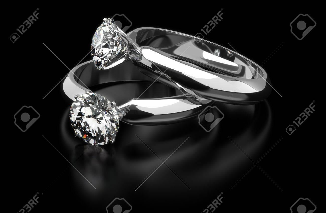 Two diamond ring on black background - 18661760