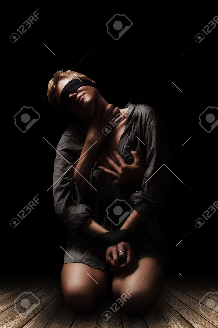 Bound woman in the arms of men Stock Photo - 9899586