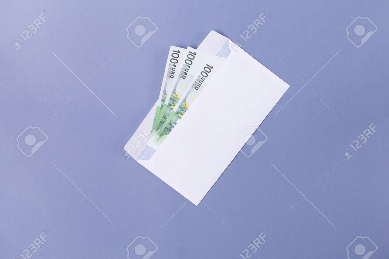 euro notes in an envelope on a blue background financial soncept