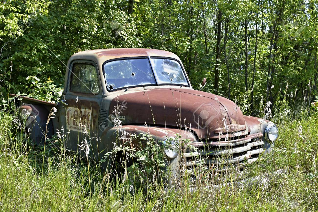 Old Abandoned Cheverolet Pickup Truck Sitting In A Field Stock Photo ...