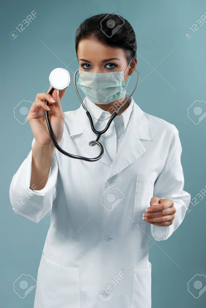 Pretty doctor examining with stethoscope (modern healthcare / medical people in studio series) Stock Photo - 6689331