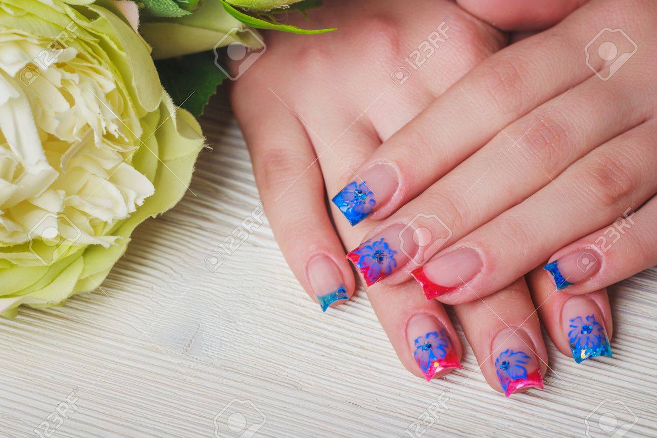 French Nail Art In Blue And Red Colors On Wooden Background Stock ...