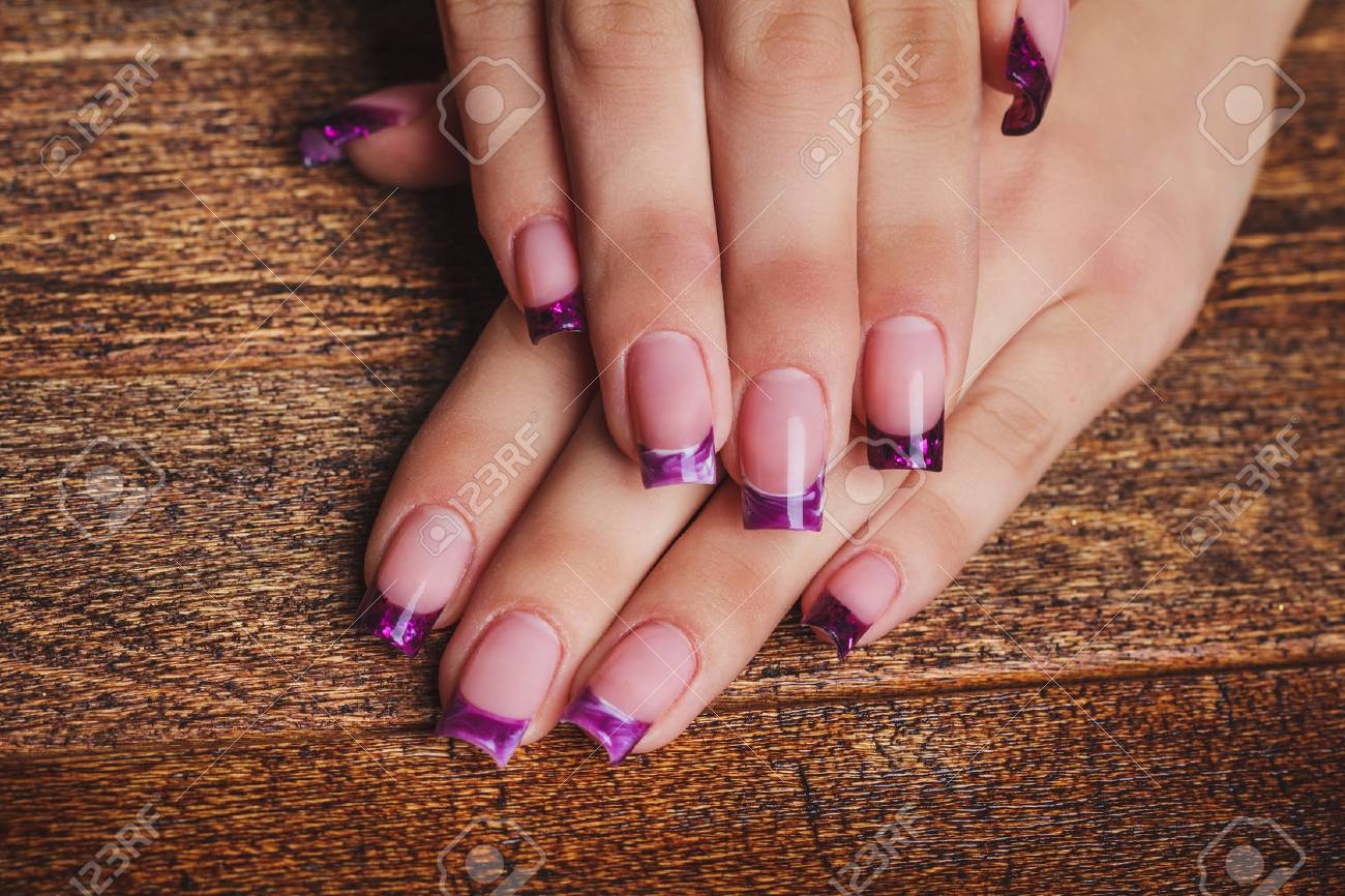French Nail Art In Purple Color On Wooden Background Stock Photo ...