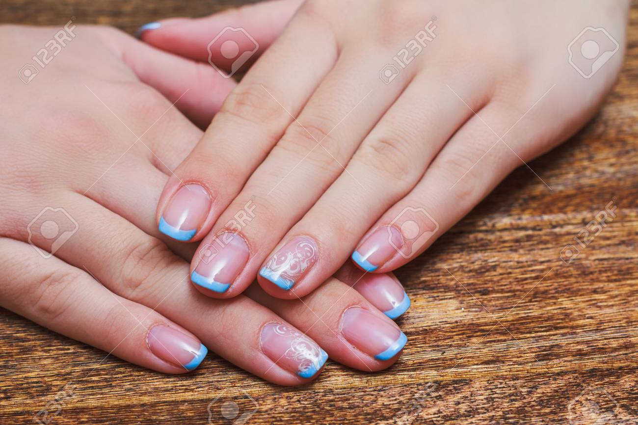 French Nail Art In Light Blue Color On Wooden Background Stock Photo ...