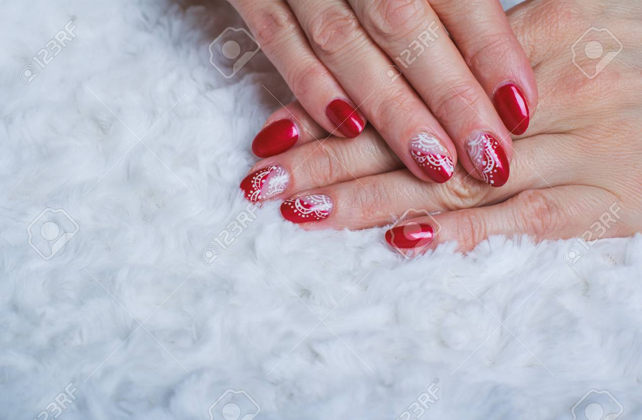 Red Nail Art With White Lace With Dots And Lines On Light Background ...