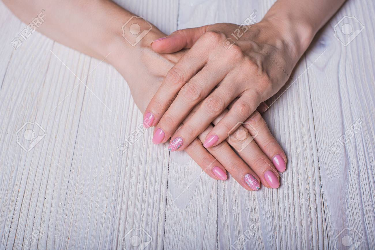 Light Pink Nail Art On Wooden Background Stock Photo Picture And