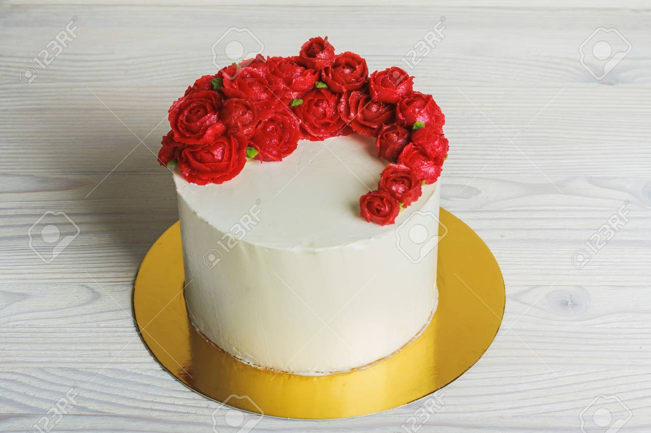 White Cake With Cream Red Roses On Light Background Stock Photo