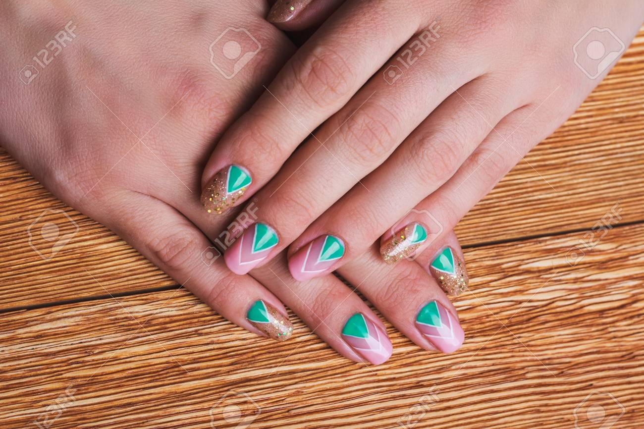 Nail Art With Bright Gold, Pink And Green Chevron Pattern On.. Stock ...