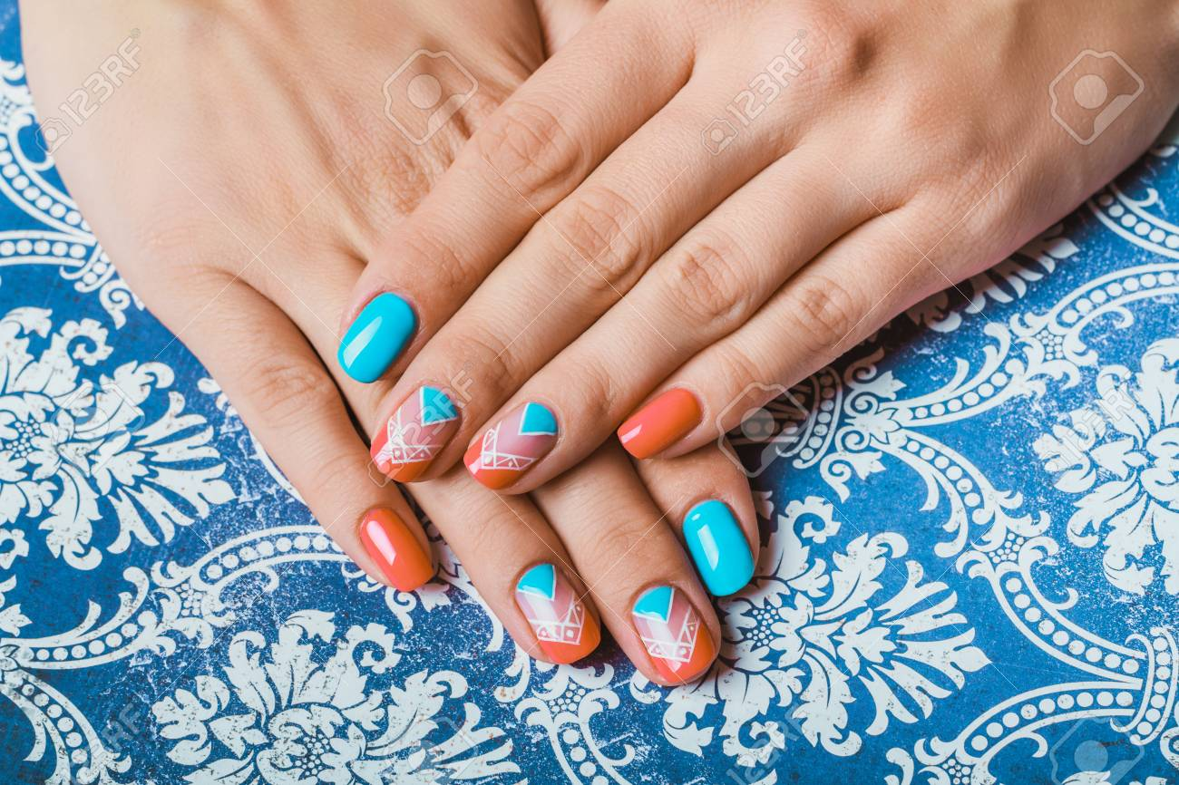 Nail Art With Bright Orange And Light Blue Chevron On Pattern